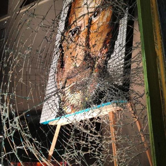 Photo of Steve Jobs painting behind the shattered glass in Cincinnati, Ohio