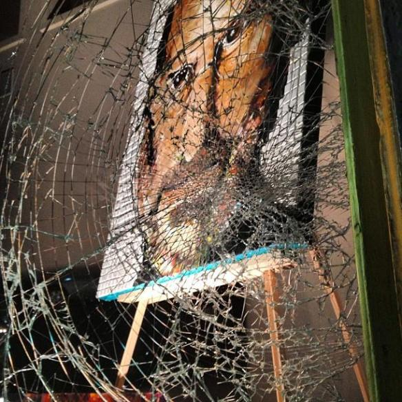 Photo of Steve Jobs painting behind the shattered glass in Cincinnati, Ohio